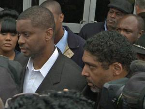John McNeil, left, accompanied by Rev. William Barber of the North Carolina chapter of the NAACP, walks out of the Cobb County Detention Center in Marietta, Ga. on Feb. 12, 2013.