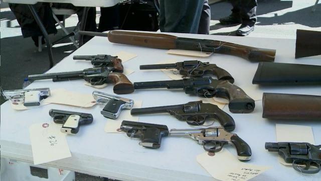 Rocky Mount police take back guns, give a little cash