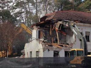 Work crews were out early Saturday to begin tearing down a landmark building on North Carolina State University's campus.