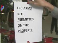 Signs barring guns could keep customers away