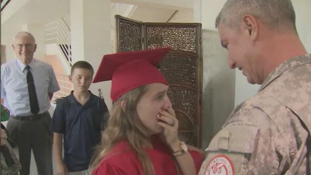 Apex grad surprised by Army dad