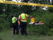 Emergency personnel stand at a staging area in the search for a missing swimmer Wednesday in Cumberland County