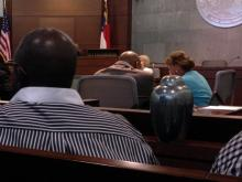 Family brings woman's remains to court for killer's plea