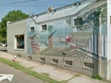 The mural on the side of a building in Raleigh's Glenwood Brooklyn historic neighborhood, before Doro Taylor painted over it.