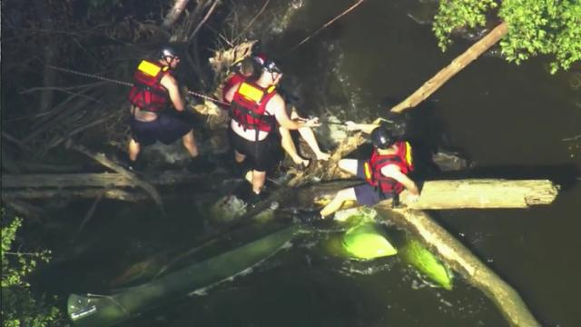 Three rescue woman on Durham County river