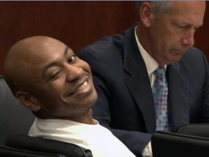 Grant Ruffin Hayes winks at a friend during jury selection in his first-degree murder trial on Aug. 26, 2013. Hayes is accused of killing his ex-girlfriend and the mother of his two sons, Laura Ackerson, in July 2011.