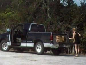 Jurors in the first-degree murder trial of Grant Hayes saw this photo on Sept. 5, 2013. The photo from a security video in Richmond, Texas, shows who investigators say is his wife, Amanda Hayes, removing cartons of acid from a truck and discarding them less than 2 miles from the home of her sister.