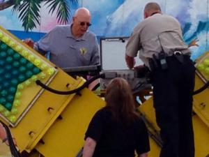 Investigators examine the control panel of the Vortex ride at the North Carolina State Fairgrounds on Oct. 29, 2013. Five people were seriously injured Oct. 24, 2013, when the equipment malfunctioned while fairgoers were getting off the ride.