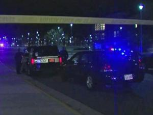 """Police and crime scene investigators respond to a shooting Nov. 2, 2013, on the campus of North Carolina A&T State University in Greensboro. Police say a 21-year-old man was wounded by a bullet fired from a """"considerable distance."""""""