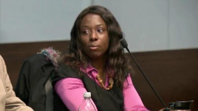 Crystal Mangum listens to pre-trial motions in her murder trial on Nov. 6, 2013.