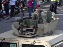 """Thousands of people lined the streets in downtown Fayetteville Saturday morning for the 15th Veterans Day parade, the biggest event of the city's annual """"Heroes Homecoming"""" celebration."""