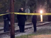 Police said Friday that human remains found Tuesday off railroad tracks south of downtown Fayetteville are those of a Fayetteville woman who has been missing for two months.