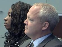 Crystal Mangum and defense attorney Daniel Meier listen to testimony on Nov. 14, 2013, during the first day of her murder trial.