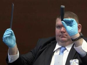 Almon Brown, a former Durham police crime scene investigator, displays to jurors on Nov. 18, 2013, one of the broken knives found in Crystal Mangum's apartment in April 2011 after she stabbed her boyfriend, Reginald Daye. Mangum is charged with murder in his death.