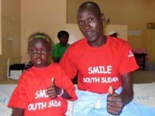 A father and daughter smile after a successful surgery to fix a cleft lip. (Photo courtesy of Cynthia Gregg)