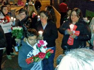 Friends and family of Jesus Huerta gathered in downtown Durham Thursday, Dec.  19, 2103. (Adam Owens / WRAL)