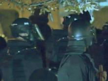 Police in riot gear confronted a shouting crowd Dec. 19, 2013, in downtown Durham. (Mark Simpson / WRAL)