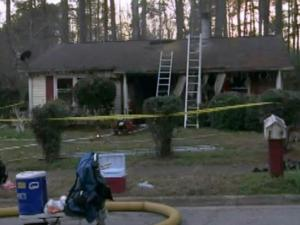 Emergency workers respond Jan. 12, 2014, to a house fire at 2516 Keith Drive in Raleigh.