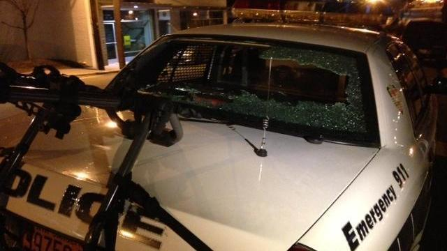 The back window of a Durham police cruiser was shattered by vandals on Jan. 19, 2014, the same night hundreds gathered to remember the Nov. 19, 2013, death of Jesus Huerta, who died after shooting himself while in police custody. (Beau Minnick/WRAL)