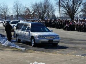 Hundreds of mourners filed into an arena at Mount Olive College on Friday, Jan. 24, 2014, to bid farewell to a beloved sheriff remembered for his larger-than-life presence in the community.