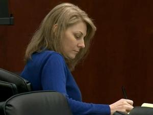 Amanda Hayes listens during her first-degree murder trial on Feb. 4, 2014, as a Texas medical examiner testifies about the autopsies he performed on Laura Ackerson's remains, which were found in a Texas creek in July and August 2011.
