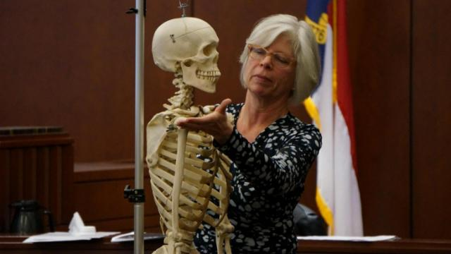 During the first-degree murder trial of Amanda Hayes on Feb. 5, 2014, North Carolina Chief Medical Examiner Dr. Deborah Radisch illustrates for jurors using a medical skeleteon the injuries to Laura Ackerson's body. (Chad Flowers/WRAL)
