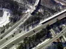 Warming afternoon temperatures helped thaw icy roads across central North Carolina on Friday after a treacherous morning commute.