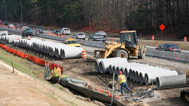 Construction crews replace piping under Interstate 440 on Wednesday, Feb. 19, 2014.