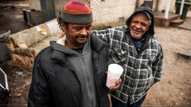 Charles Jones and Buddy Dunn on Progress Street in Massey Hill, one of Fayetteville's struggling neighborhoods.