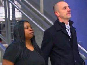 Latoya Barnes was the first to turn herself in Tuesday night for allegedly falsifying electronic records in over 300 cases to show bondsmen who paid their client's bail when they did not.