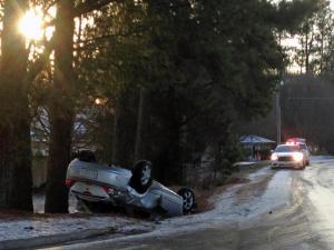 A four-door sedan overturned early Tuesday, March 4, 2014, near the intersection of Casa Street and Horton Road due to icy roads.