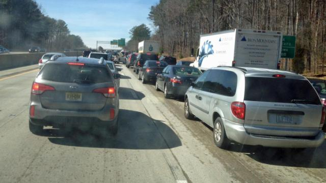Once drivers hit the road, congestion and slick spots combined to back up Tryon Road in Cary.