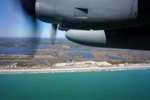 Members of the 440th Airlift Wing perform a medical evacuation training exercise over the Outer Banks on March 10, 2014.