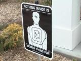 Nothing inside is worth dying for sign
