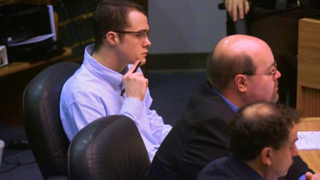 Jonathan Douglas Richardson listens to testimony in his first-degree murder trial on March 18, 2014.