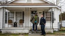 Officer Harrison Combs talks with Gregory Coley about an abandoned house across the Powell Street. March 18, 2014. Photo by James Robinson of The Fayetteville Observer.