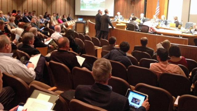 Dozens of business owners packed a Raleigh City Council meeting on April 1, 2014, to speak against proposed changes to the city's sign ordinance.