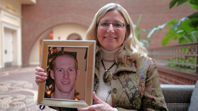 Freida MacDonald holds a photo of her son, Stephen Hoyle, who was murdered in January 2012.