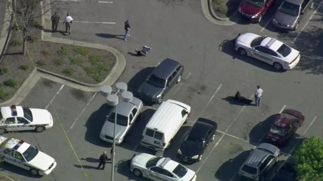 Authorities responded to a call of shots fired outside Northgate Mall on Thursday, April 10, 2014. No one was hurt. Two men were handcuffed in the parking lot and being questioned by officers.