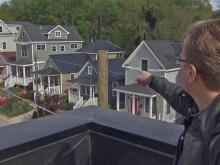 Builders Richard Johnson points to the homes he worked on in Raleigh's Boylan Heights.