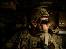 Spc. Jonathan Hawley, of the 2nd Battalion, 508th Parachute Infantry Regiment, looks out the window from the back of an MRAP vehicle, as it drives through Kabul, Monday, April 16, 2014.