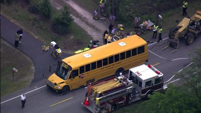 A school bus and vehicle collided on U.S. 401 South near Lillington on May 9, 2014.