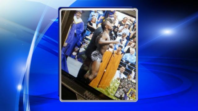 Quinton Murphy dropped his robe in front of a graduation crowd at the Jack Britt ceremony Wednesday night. (Photo courtesy: Lauren LeMay)