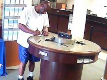 Surveillance video captured this image of a man wanted in the robbery of a SunTrust Bank in Durham on June 13.