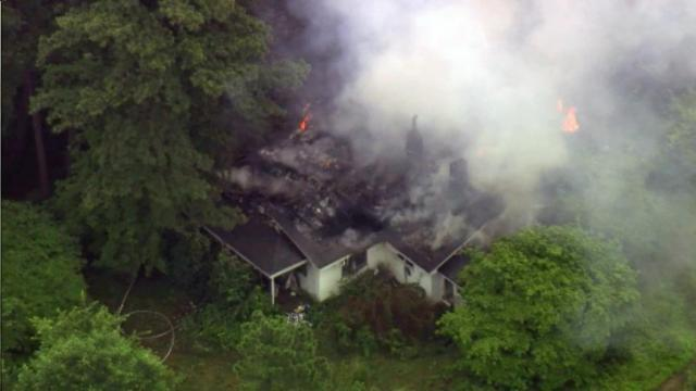 Crews battle house fire in Raleigh