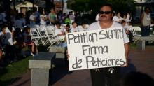More than 200 people attended a vigil and marched through downtown Benson Wednesday night to save local pastor Jose Armando Siliezar-Sevilla from deportation. (Adam Owens/WRAL)