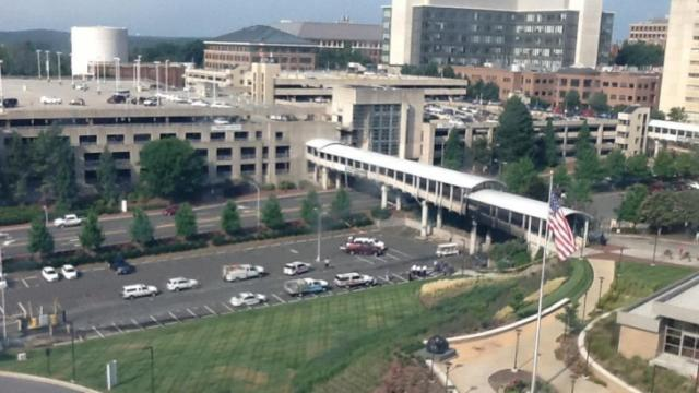 A bridge linking UNC Hospitals with the Dogwood Parking Deck was closed Monday after a fire underneath the walkway left it damaged. (Photo by Alan Walton)