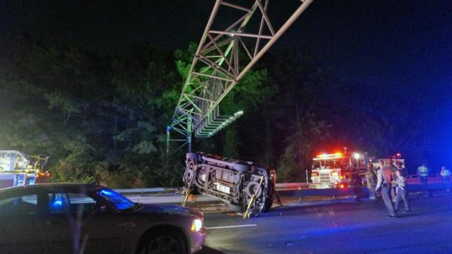 Authorities closed all lanes of Interstate 440 near Hillsborough Street early Tuesday after an SUV overturned and landed on the guardrail separating eastbound and westbound lanes.