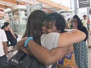 Latiesa Kirkpatrick and Karen Roundtree embrace at Raleigh-Durham Internation Airport on Saturday, July 19, 2014.