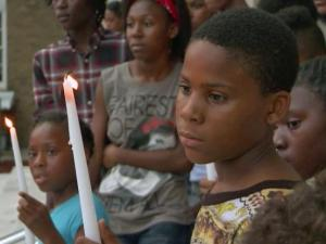 More than 100 people gathered outside the Wilson County Courthouse Sunday, July 27, 2014, to remember 7-year-old Kamari Jones, who was killed by a bullet while inside his home four days earlier.
